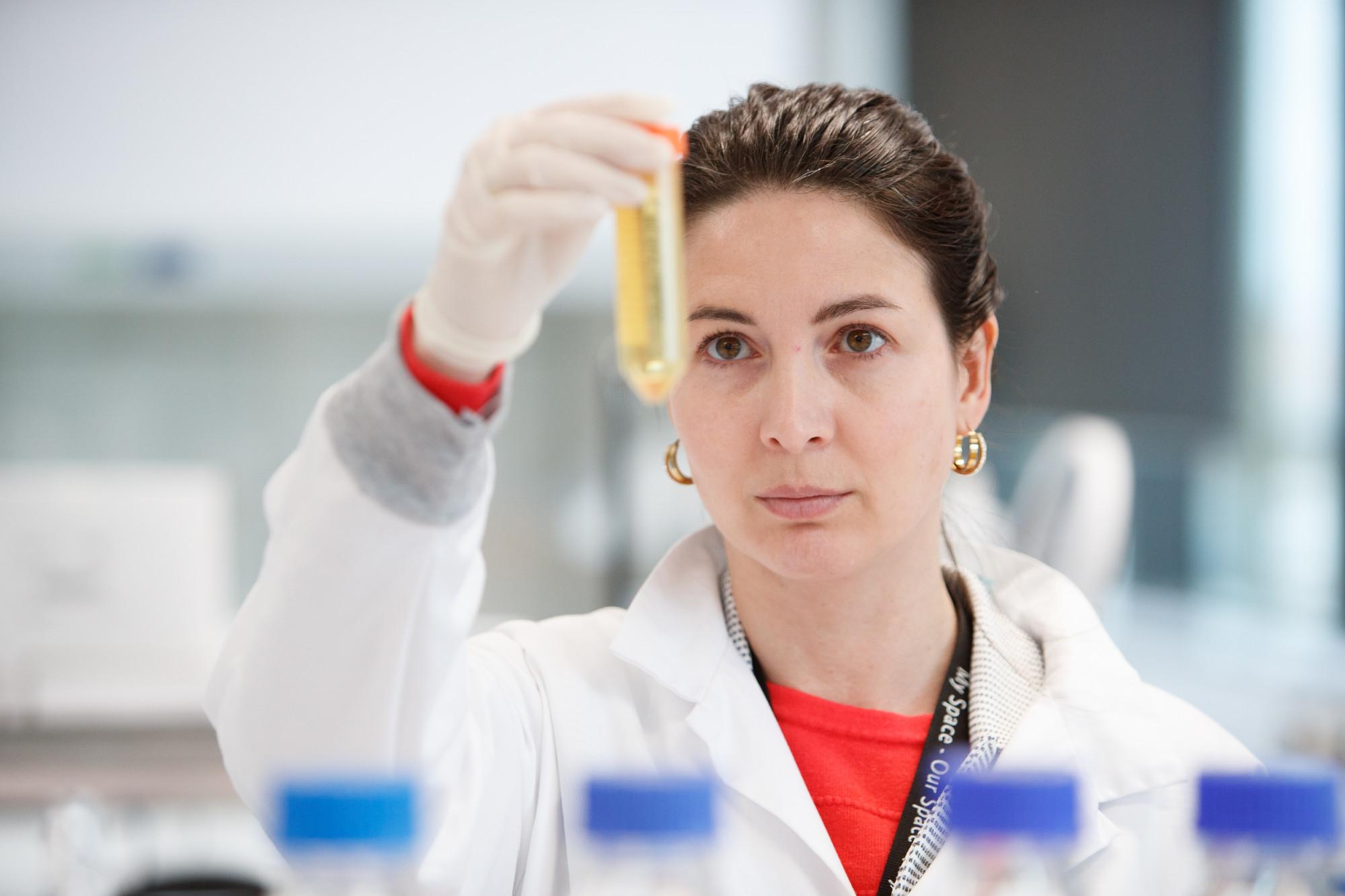 Scientist holding test tubes
